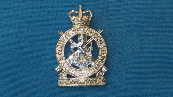 The Kent&County of London Yeomanry cap badge.