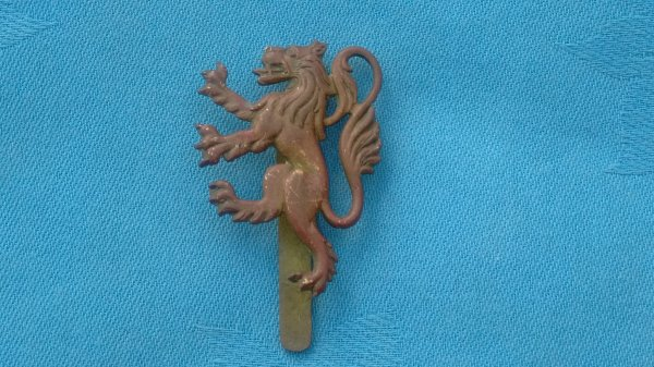 The Manchester University Officers Training Corp cap badge.