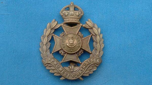 The 8th Battalion POW West Yorkshire Regiment cap badge.