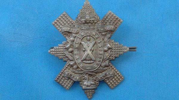 The Royal Highlanders Black Watch cap badge.