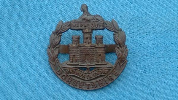 The Dorsetshire Regiment Officers Service Dress cap badge.
