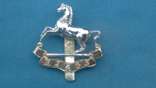 The Liverpool University Officers Training Corp cap badge.,