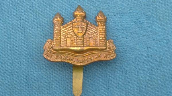 The Cambridgeshire Regiment cap badge.