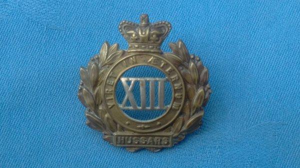 The 13th Hussars cap badge.