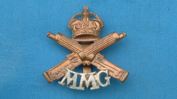 The Motor Machine Gun Corp cap badge.