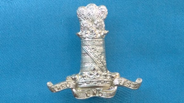 The 11th Hussars cap badge.