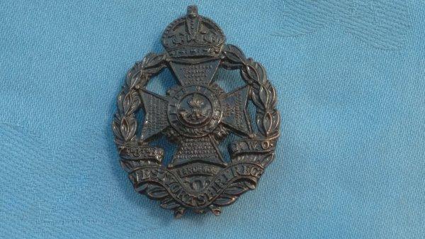 The 7th/8th Battalions West Yorkshire Regiment cap badge.