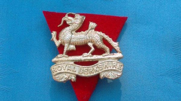 The Royal Berkshire Regiment cap badge.