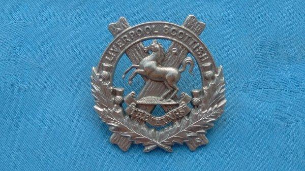 The 10th Battalion Kings Liverpool Regiment cap badge.