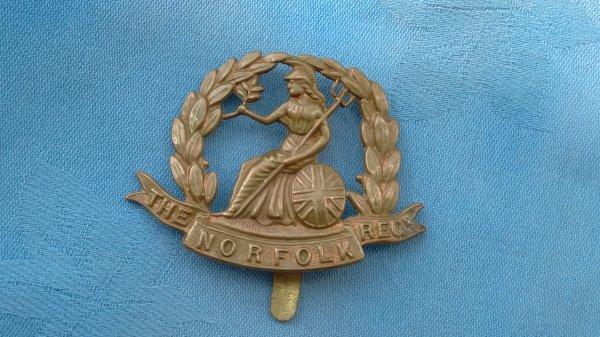 The Norfolk Regiment cap badge.