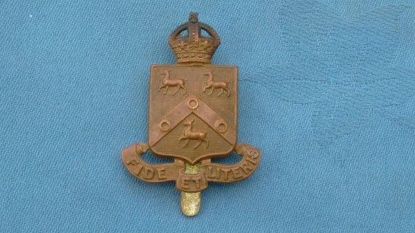 St Pauls London Officers Training Corp cap badge.