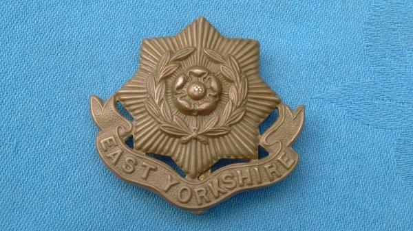 The East Yorkshire Regiment cap badge.