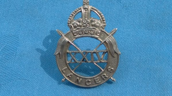 The 24th Lancers cap badge.