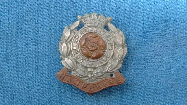 The 6th Battalion Hampshire Regiment cap badge.