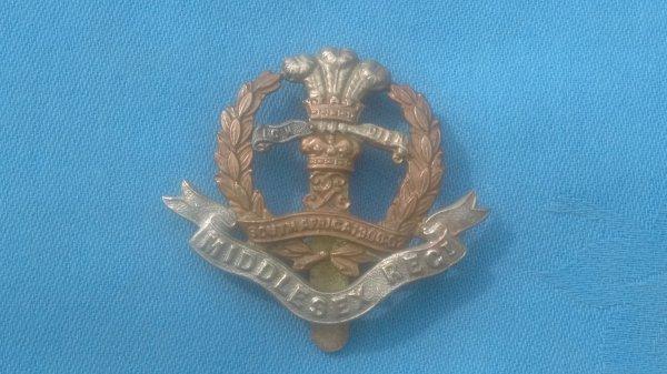 The Middlesex Territorials cap badge.