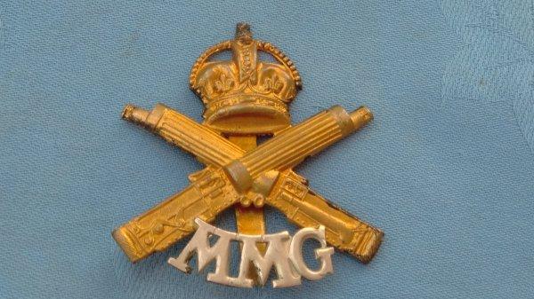 The Motor Machine Gun Corp cap badge.