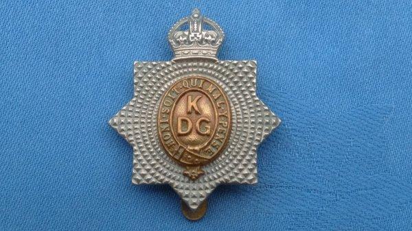 The 1st Kings Dragoon Guards cap badge.