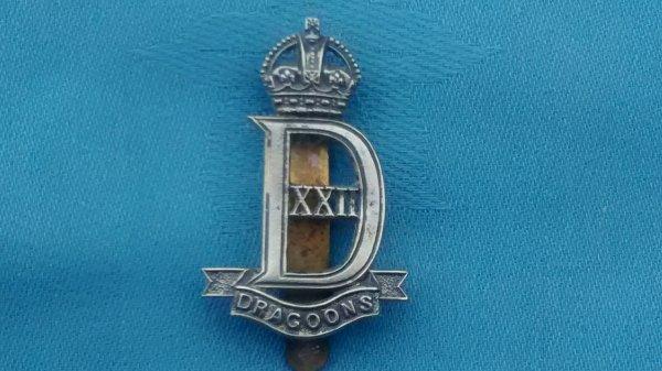 The 22nd Dragoons cap badge.
