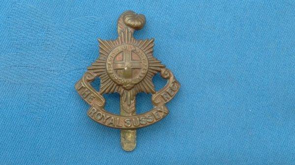 The Royal Sussex Regiment cap badge.