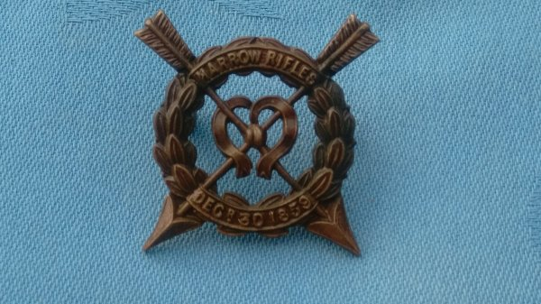The Harrow Rifles Officers Service Dress cap badge.