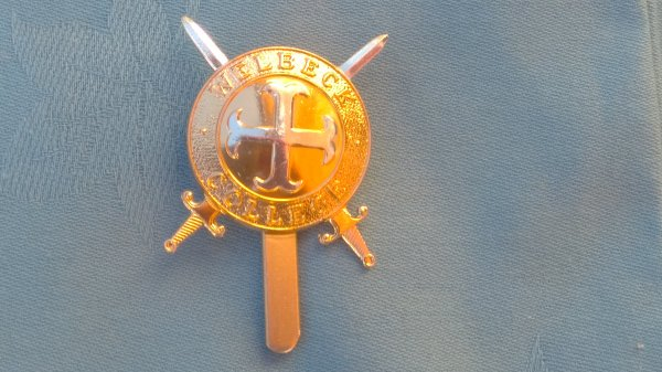 The Welbeck College Officers Training Corp cap badge.