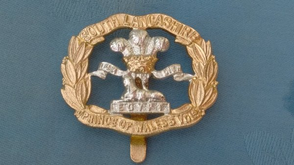 The Prince of Wales own South Lancashire Regiment cap badge.