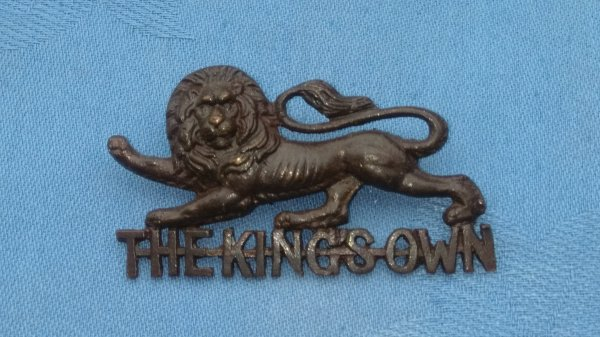 The Kings own Regiment Officers Service Dress cap badge.
