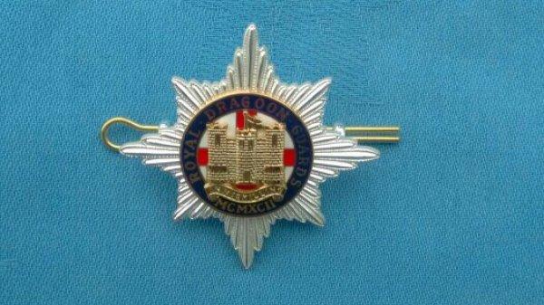 The Royal Dragoon Guards Officers cap badge.