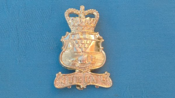 The University of Belfast Officer Training Corp cap badge.