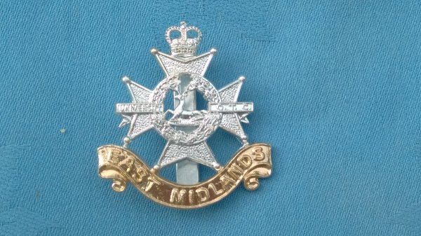 The East Midlands University Officers Training Corp cap badge.