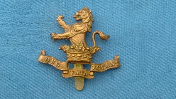 The 7th Dragoon Guards cap badge.