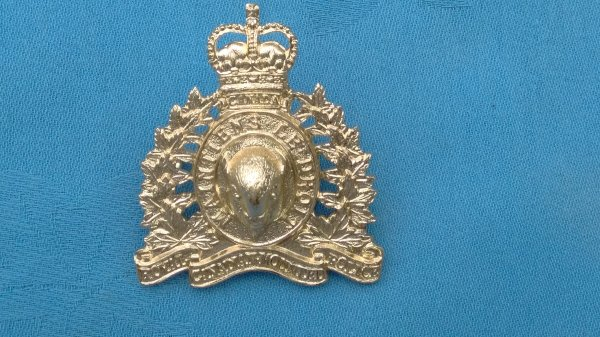 The Royal Canadian Mounted Police cap badge.