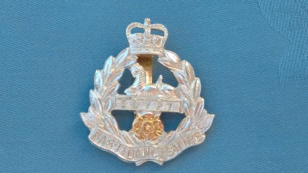The East Lancashire Regiment cap badge.