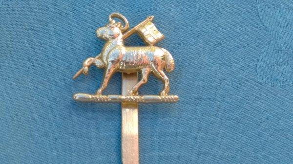 The Queens Royal West Surrey Regiment cap badge.