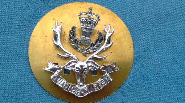 The Queens own Highlanders cap badge.