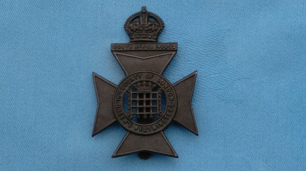 The 16th Battalion County of London Regiment cap badge.
