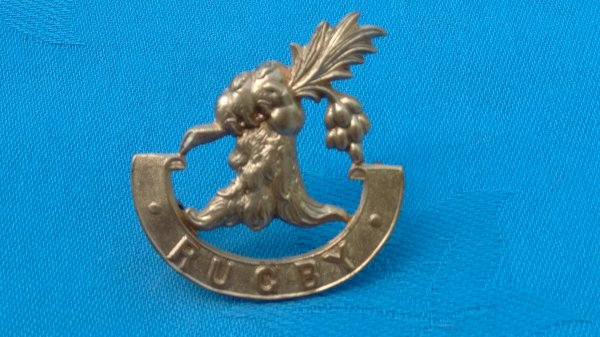 The Rugby School Warwickshire Officers Training Corp cap badge.