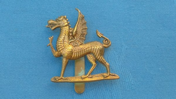The Monmouthshire School Officers Training Corp cap badge.