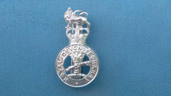 The Royal Devon Yeomanry cap badge.