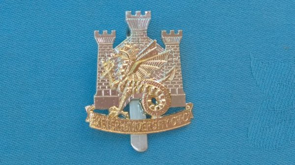 The Exeter University Officer Training Corp cap badge.