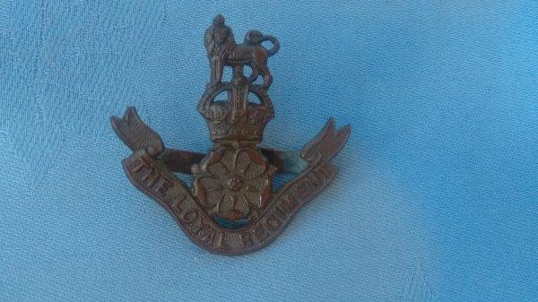 The Loyal Regiment Officers Service Dress cap badge.