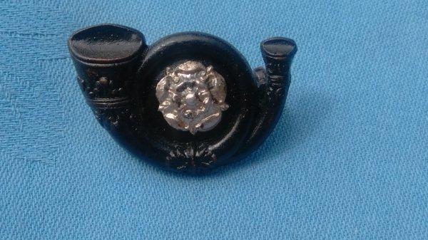The Kings own Yorkshire Light Infantry Officers cap badge.