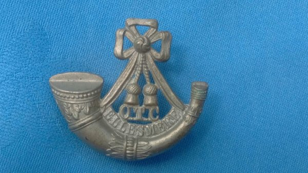 The Ellesmere College Shropshire Officer Training Corp cap badge.