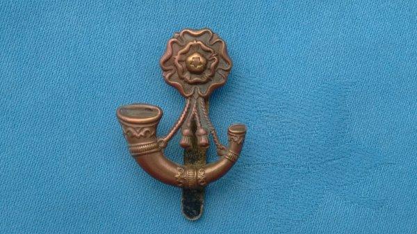The 6th Battalion Kings Liverpool Regiment cap badge.