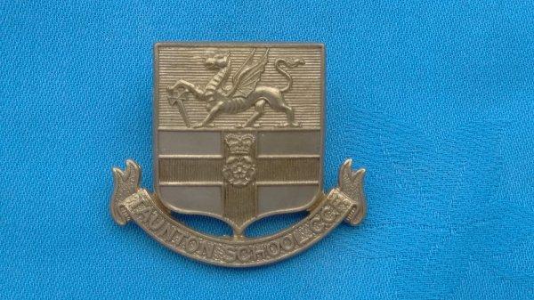 The Taunton School Combined Cadet Force cap badge.