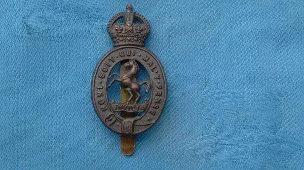 The Royal East Kent Yeomanry cap badge.