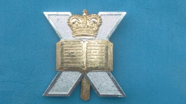 The Edinburgh University Officer Training Corp cap badge.