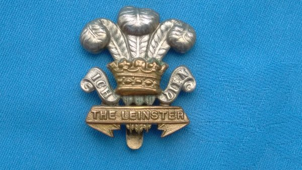 The Leinster Regiment ( Royal Canadians )  Curly Scrolls cap badge.