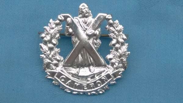 The Queens Cameron own Highlanders cap badge.
