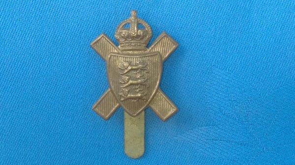 The Royal Jersey Light Infantry 11th Battalion Hampshire Regiment cap badge.